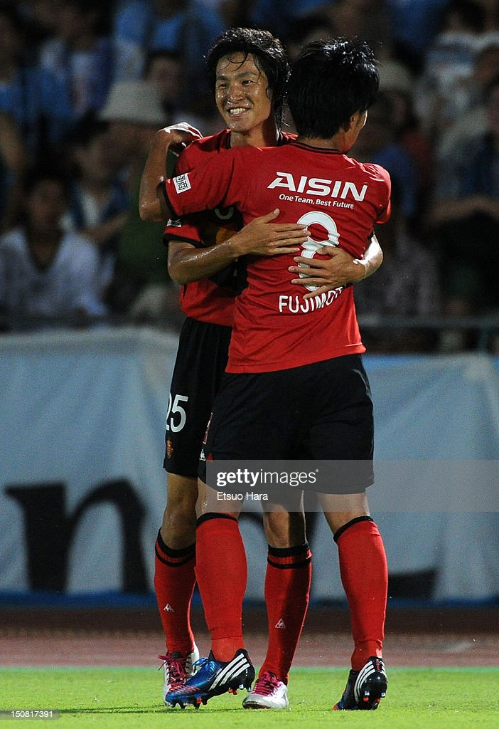 Mu Kanazaki of Nagoya Grampus celebrates scoring their first goal with his team mate Jungo Fujimoto during the J.League match between Kawasaki Frontale and Nagoya Grampus at Todoroki Stadium on August 25, 2012 in Kawasaki, Japan.