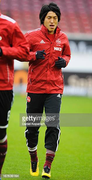 Mu Kanazaki of Nuernberg warms up prior the Bundesliga match between VfB Stuttgart and 1. FC Nuernberg at Mercedes-Benz Arena on February 23, 2013 in...