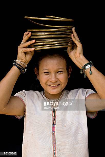 Mu Pan a 16year old girl from Huay Pu Keng village shows the rings she had to remove for medical reasons after wearing them for seven years But now...