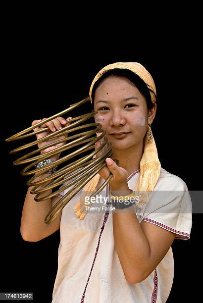 Mu Sar a 18year old woman from Huay Pu Keng village shows the rings she has decided to remove after wearing them for 13 years because with the rings...