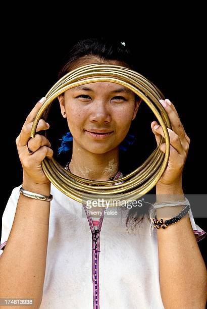 Mu Thoung a 17year old woman from Huay Pu Keng village shows the rings she has decided to remove after wearing them for 10 years Without the rings...