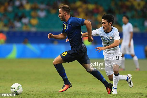 Muamer Tankovic of Sweden and Ryota Ohshima of Japan compete for the ball during the Men's Football Group B match between Japan and Sweden at Arena...