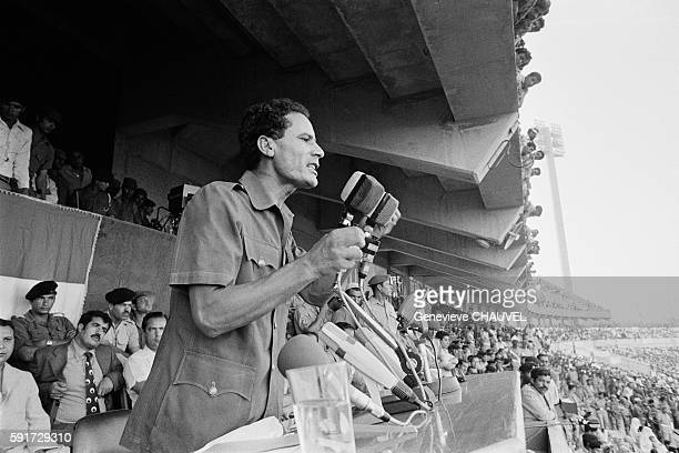 Muammar alGaddafi gives a speech to demonstrators gathered to show support for his return after he resigns as leader of the Revolutionary Command...
