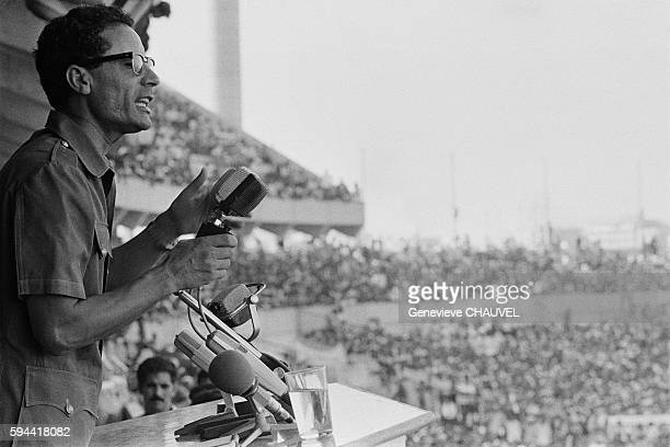 Muammar alQuaddafi gives a speech to demonstrators gathered to show support for his return after he resigns as leader of the Revolutionary Command...