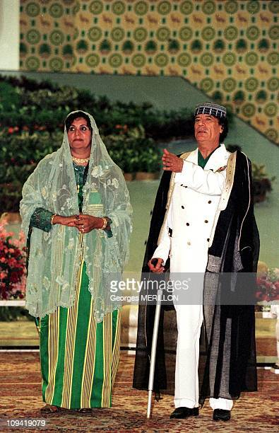 Muammar Gaddafi welcomes delegations arriving for the african unity organization with his wife Safia