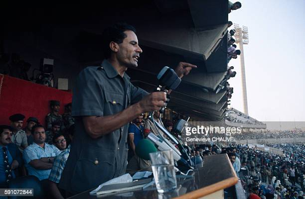 Muammar Qaddafi delivers a speech to demonstrators gathered in a show of support for his return following his resignation as leader of the...