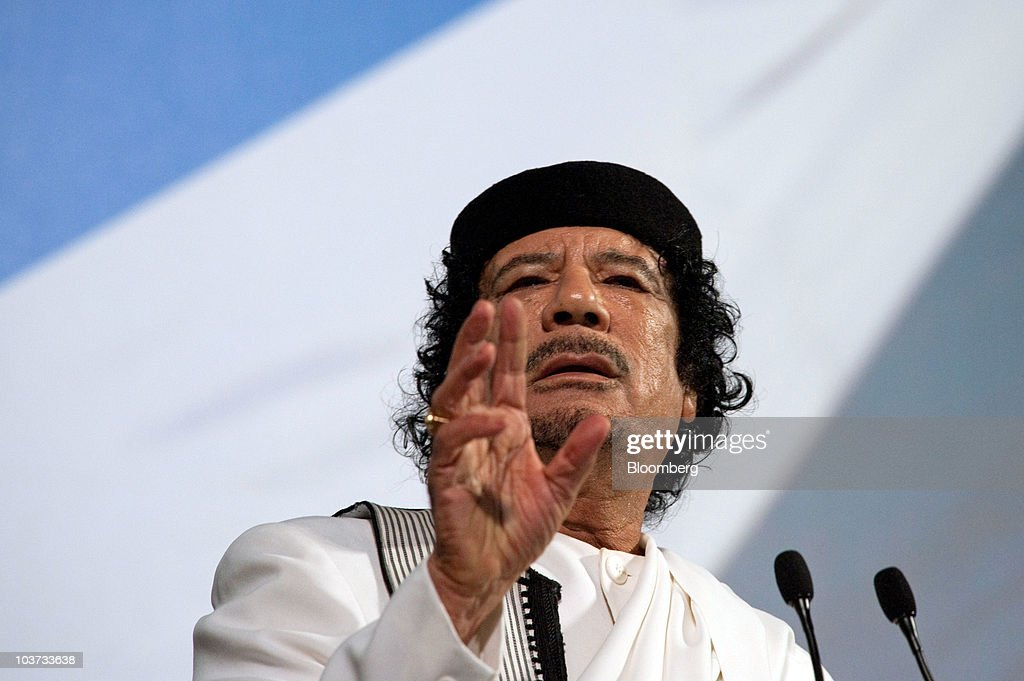 Muammar Qaddafi, Libya's leader, speaks at an equestrian show at the Tor di Quinto cavalry school in Rome, Italy, on Monday, Aug. 30, 2010. Italy's 2008 apology to Libya for three decades of colonial rule is paying dividends for Italian companies including Eni SpA and Finmeccanica SpA. Photographer: Victor Sokolowicz/Bloomberg via Getty Images