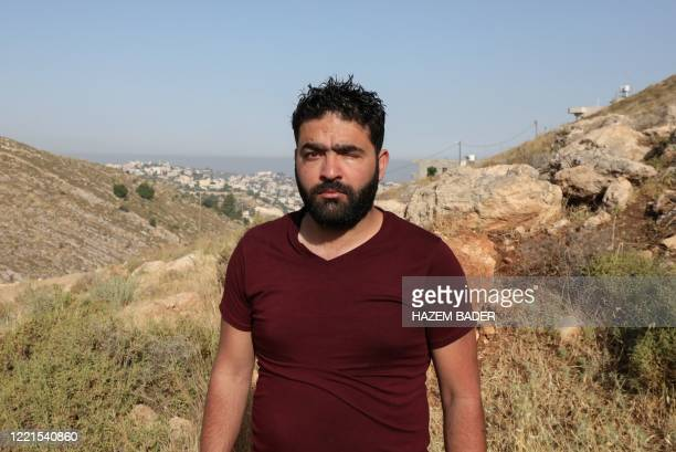 Muath Amarneh, who lost his left eye, stands at the place where he was shot in the village of Surif, north of Hebron in the occupied West Bank on...