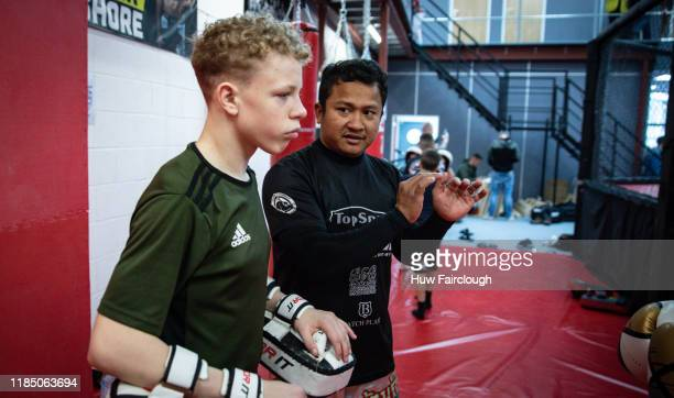 Muay Tai coach Somkiat Chokkueaat coaches a student during his class at his class at the opening of Shore Mixed Martial Arts on November 2 2019 in...