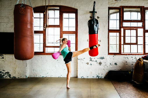 Muay thai boxer during training session practicing - gettyimageskorea