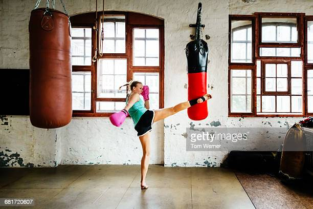 Muay thai boxer during training session practicing