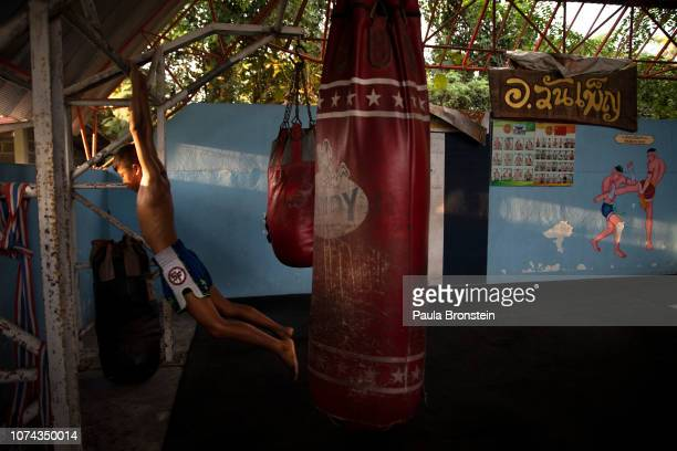 Muay Thai boxer Ek Phuton practices daily at the Nor Naksin Muay Thai boxing camp December 7 2018 in Saraburi Thailand Muay Thai boxing is considered...
