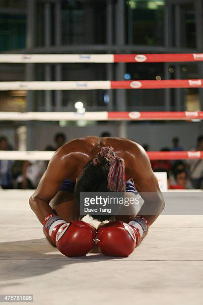 Muay Thai boxer performing his prefight rituals