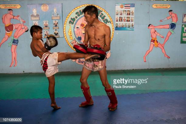 Muay Thai boxer Samsun gets some mentoring from Japanese fighter Tarunsan during practice at the Nor Naksin Muay Thai boxing camp December 7 2018 in...