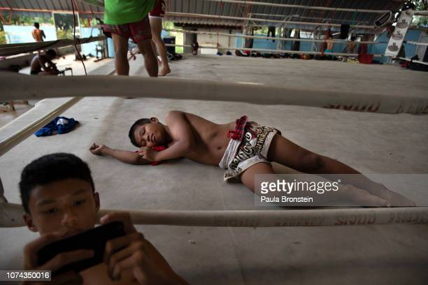 Muay Thai boxer Samsun rests after practice at the Nor Naksin Muay Thai boxing camp December 7 2018 in Saraburi Thailand Muay Thai boxing is...