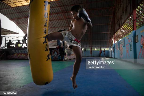 Muay Thai boxer Samsun works out during daily practice at the Nor Naksin Muay Thai boxing camp December 7 2018 in Saraburi Thailand A professional...