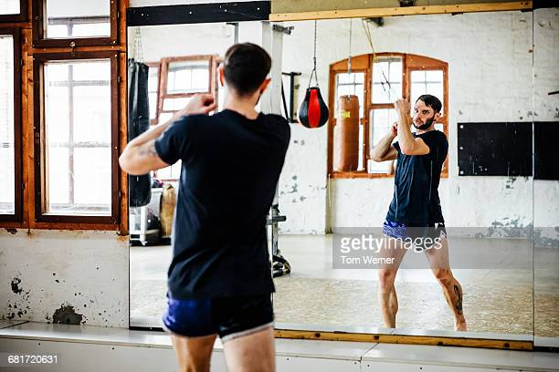 Muay Thai Boxer training in front of a mirror