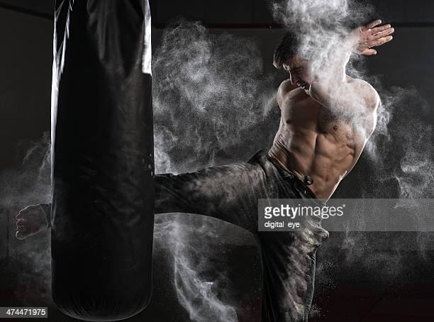 Muay Thai boxer with powder