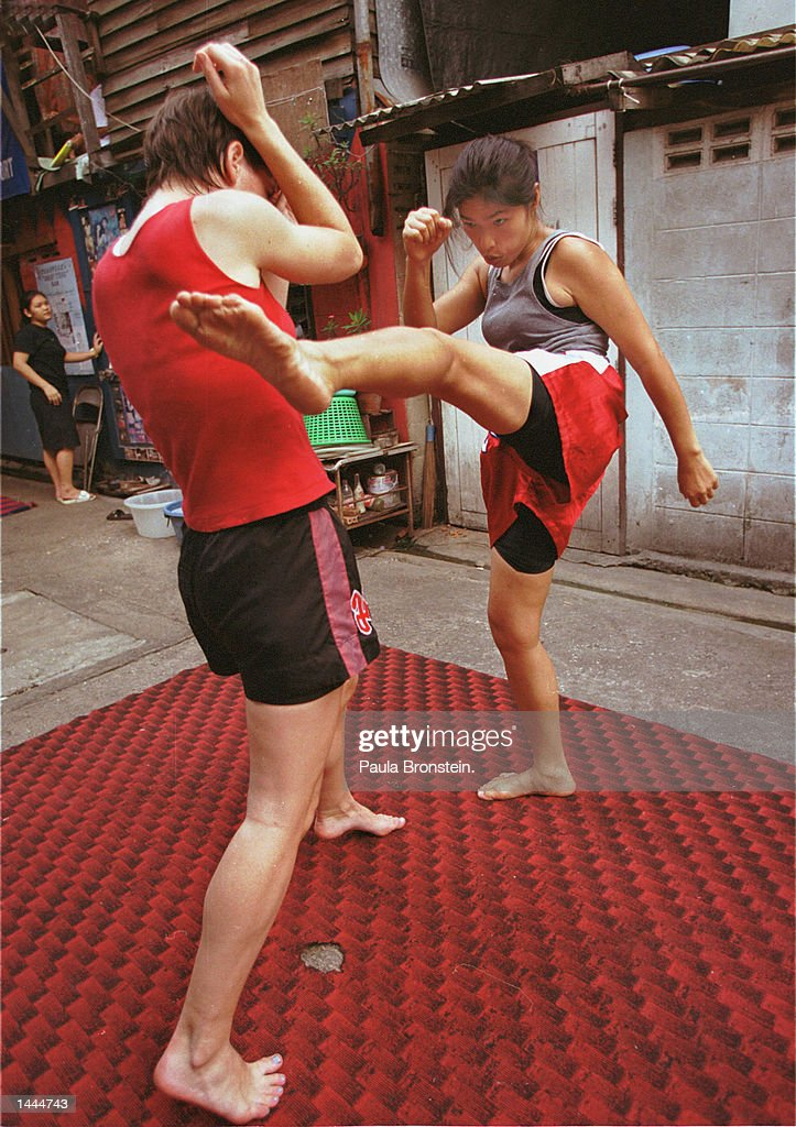Muay Thai boxers Boonterm, right, and Niamh spar with each other at Jitti''s Gym May, 2000 in Bangkok, Thailand.