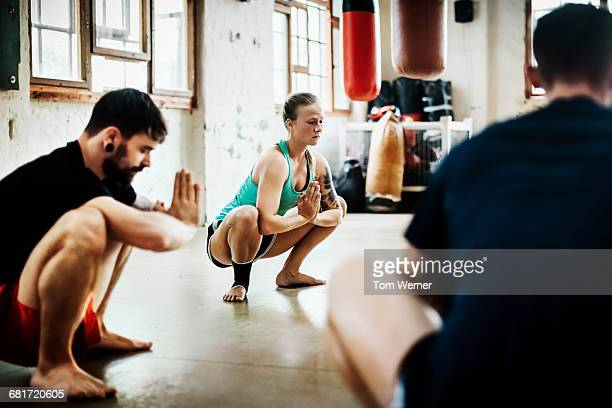 Muay Thai Boxing athletes stretching in a gym