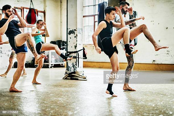 Muay thai boxing athletes training in a gym