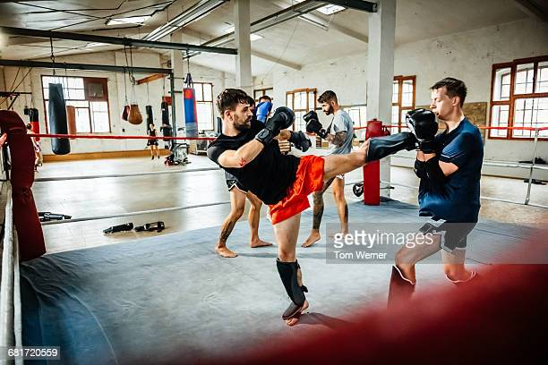 Muay thai boxing athletes training in boxing ring