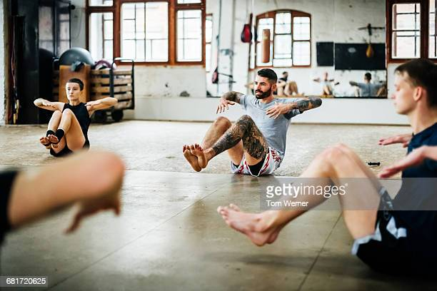muay thai boxing athletes warming up - barfuß stock-fotos und bilder