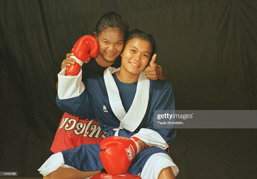Muay Thai female fighters Soidao and Jaeda pose together before a fight at Rangsit stadium May, 2000 in Bangkok, Thailand.