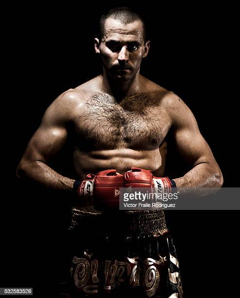 Muay Thai Kickboxing fighter Brian poses at Fighting Spirit Gym in Bangkok Thailand Muay Thai also know as 'Art of Eight Limbs' is a combat martial...