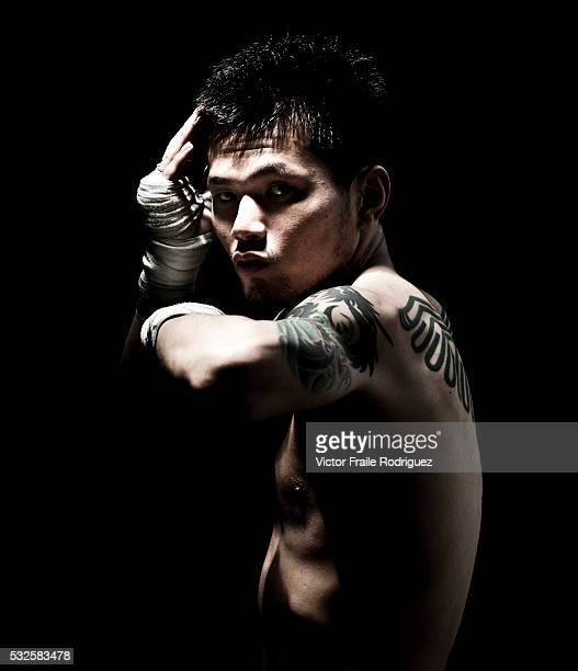 A muay thai Kickboxing fighter from the Rompo Gym poses in Bangkok Thailand Muay Thai also know as 'Art of Eight Limbs' is a combat martial art and...