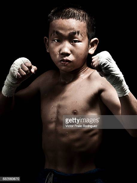 Muay Thai Kickboxing fighter Petchwiengian of Laos poses at Sangmorakot gymnasium in Bangkok Thailand Muay Thai also know as 'Art of Eight Limbs' is...
