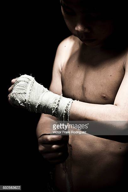 Muay Thai Kickboxing fighter Suwanaked poses at Sangmorakot gymnasium in Bangkok Thailand Muay Thai also know as 'Art of Eight Limbs' is a combat...