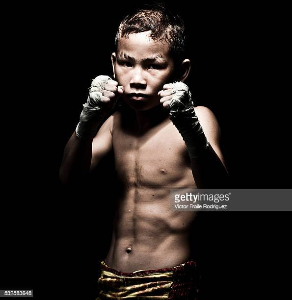 Muay Thai Kickboxing fighter Suwanaked poses at Sangmorakot gymnasium in Bangkok Thailand Muay Thai also know as Art of Eight Limbs is a combat...