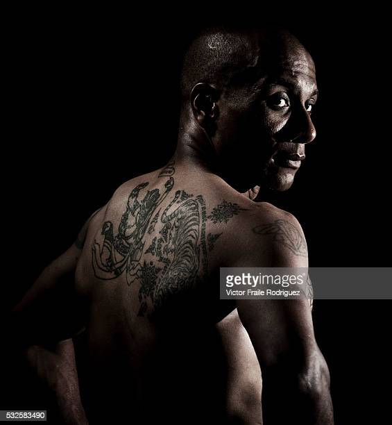 Muay Thai Kickboxing fighter Thierry Virapol poses at a gymnasium in Bangkok Thailand Muay Thai also know as 'Art of Eight Limbs' is a combat martial...
