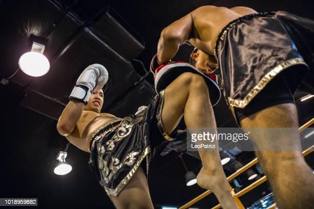 muay thai match on boxing ring in thailand - muay thai imagens e fotografias de stock
