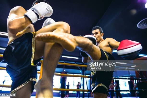 Muay Thai match on boxing ring in Thailand
