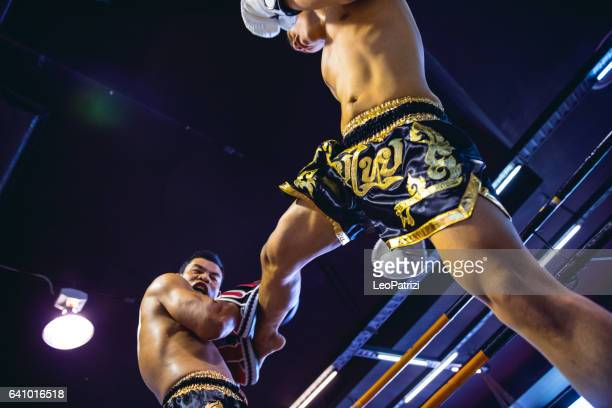 muay thai match on boxing ring in thailand - muay thai imagens e fotografias de stock