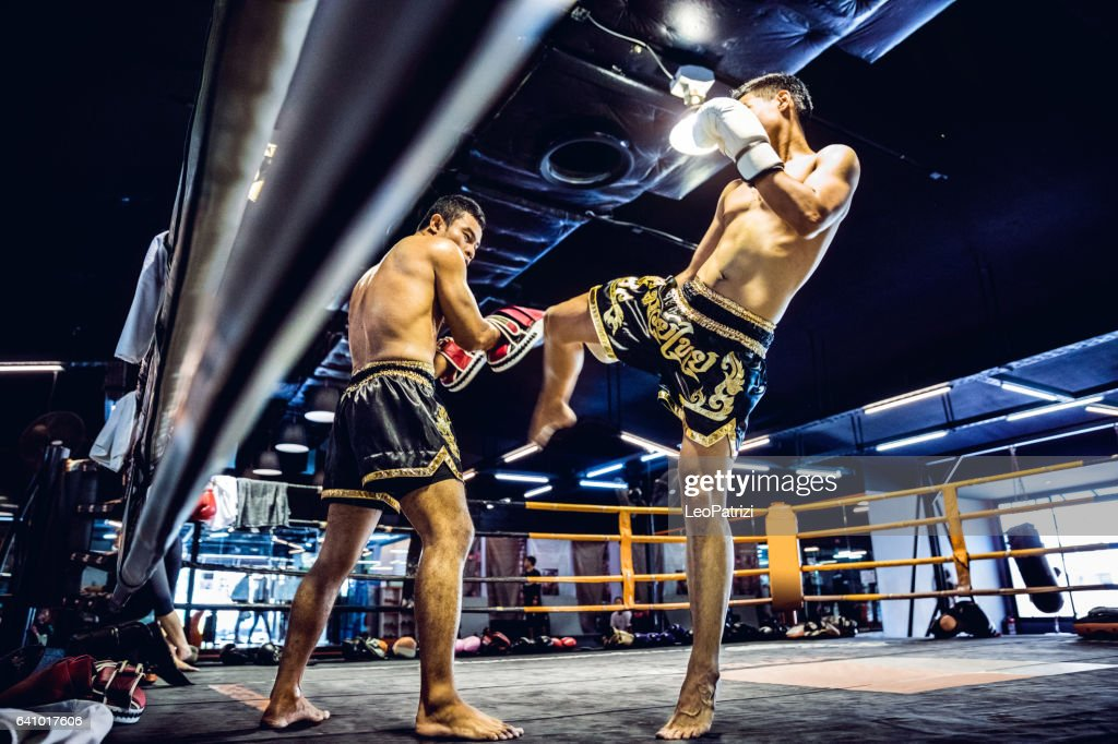 Muay Thai match on boxing ring in Thailand : Stock Photo