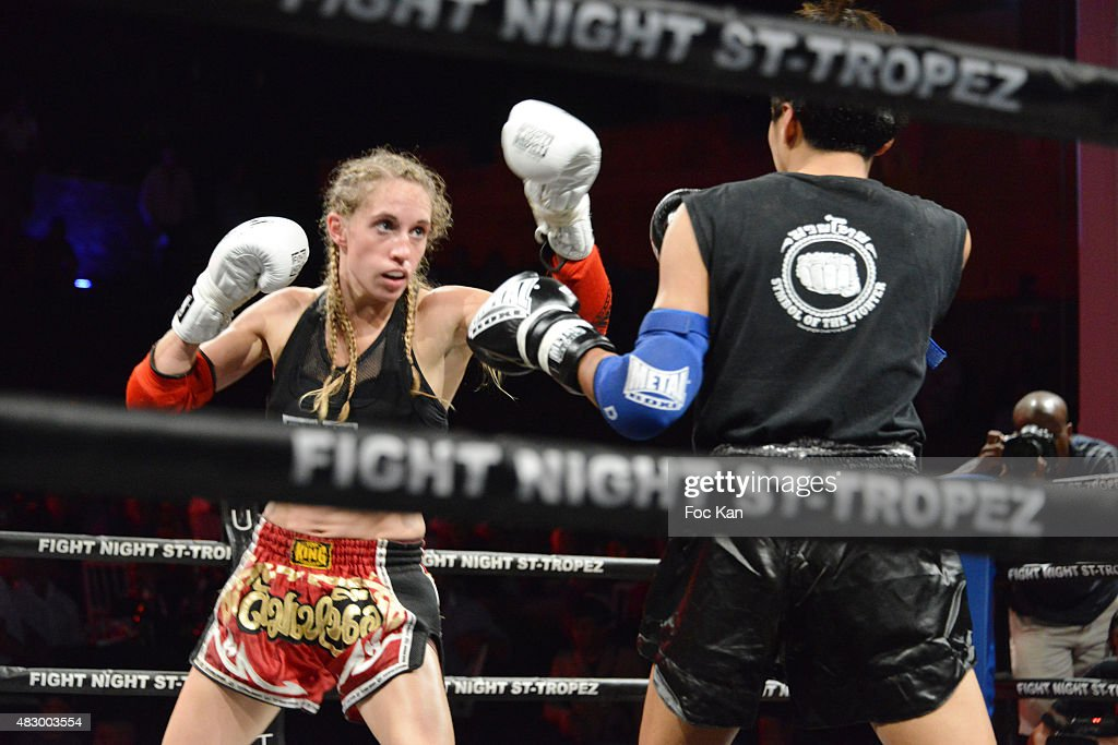 Muaythai champions Lizzie Largilliere and Petchoydying Mor fight during the 'Fight Night 2015' Gala Show at La Citadelle de Saint Tropez on on August 4, 2015 in Saint-Tropez, France.
