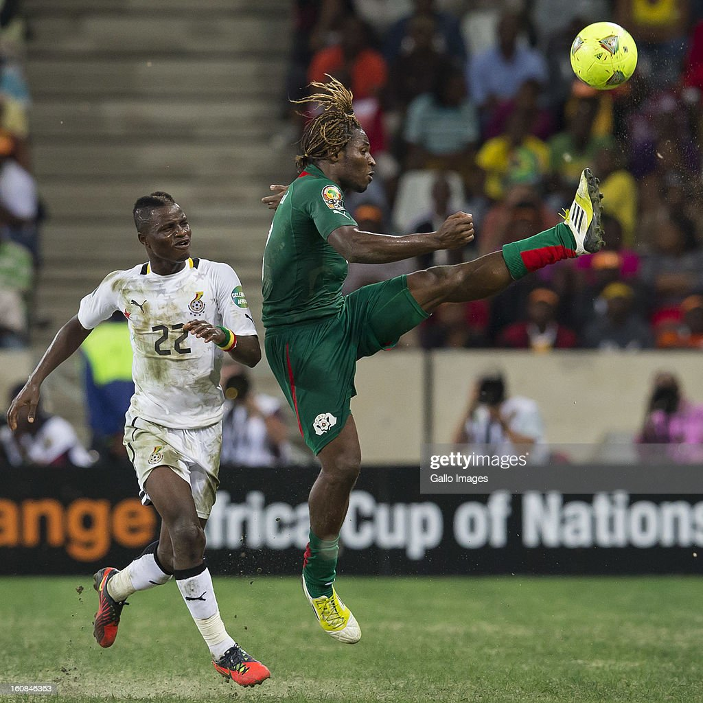 Mubarak Wakaso from Ghana and Keba Paul Koulibaly from Burkina Faso (R) competes for the ball during the 2013 Orange African Cup of Nations 2nd Semi Final match between Burkina Faso and Ghana at Mbombela Stadium on February 06, 2013 in Nelspruit, South Africa.