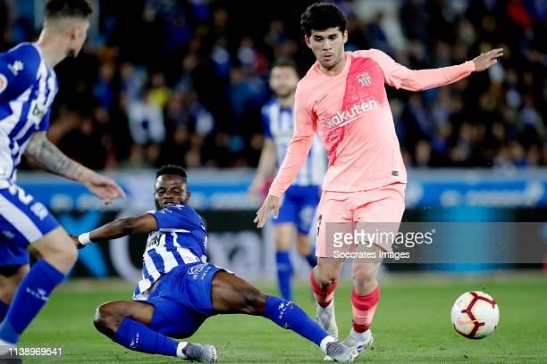 Mubarak Wakaso of Deportivo Alaves Carles Alena of FC Barcelona during the La Liga Santander match between Deportivo Alaves v FC Barcelona at the...
