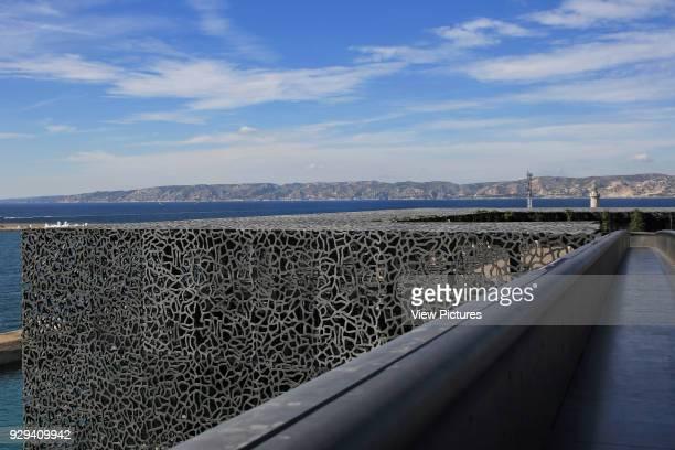 MuCEM Marseille France Architect Rudy Ricciotti 2013 Detail of walkway bridge with Mediterranean coast beyond