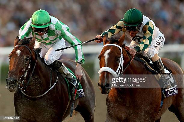 Mucho Macho Man riden by Gary Stevens crosses the finish line ahead of Declaration of War riden by Joseph O'Brien to win the Breeders' Cup Classic...