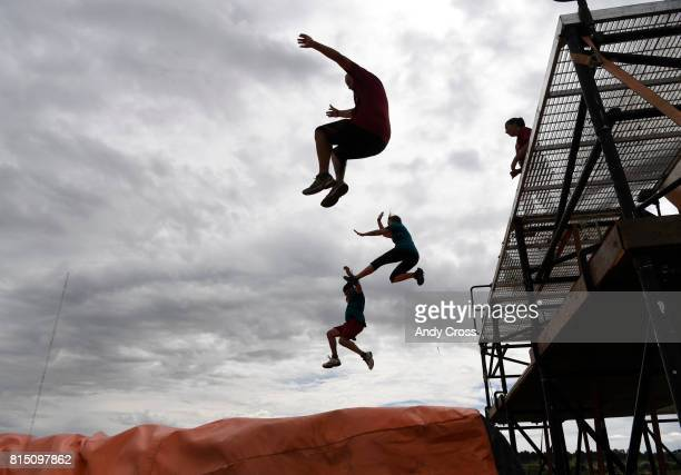 MuckFest MS Denver participants jump off a platform onto a huge airbag obstacle July 15 2017 at Salisbury North in Parker Thousands of thrillseekers...