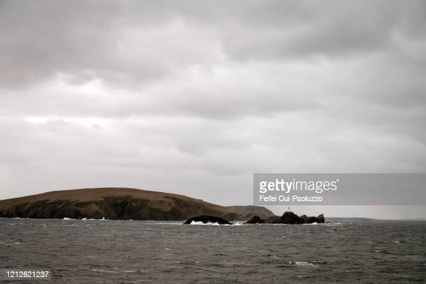 muckle flugga lighthouse and rock at muckle flugga, unst island, scotland - nature reserve stock pictures, royalty-free photos & images