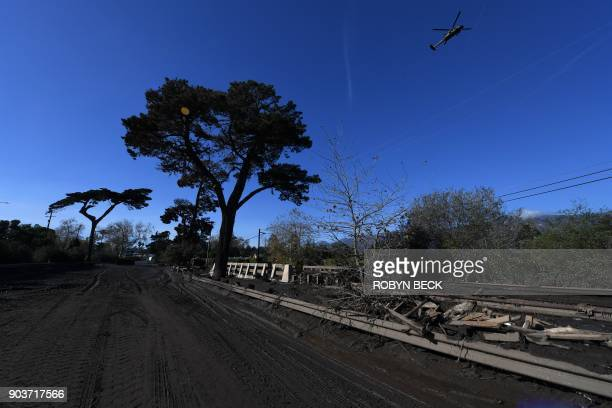 Mud and debris fill a section of US Highway 101 January 10 2018 after a massive mudflow in Montecito California flooded the highway causing a 30 mile...