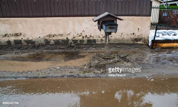 Mud and flood water surround a mailbox in front of a home off La Tuna Canyon as heavy rains caused street flooding and debris flow on March 21 2018...