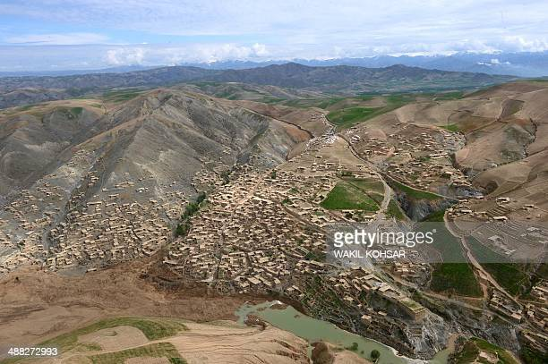 Mud and rocks of the landslide are seen in this aerial view of Aab Bareek village at Argo district in Badakhshan province on May 5 2014 Afghan...