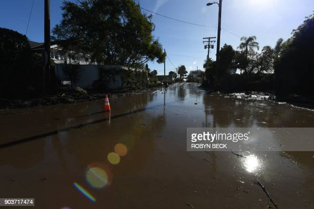 Mud and water still fill a street near Montecito California January 10 2018 following a massive mudflow Search and rescue efforts intensified January...