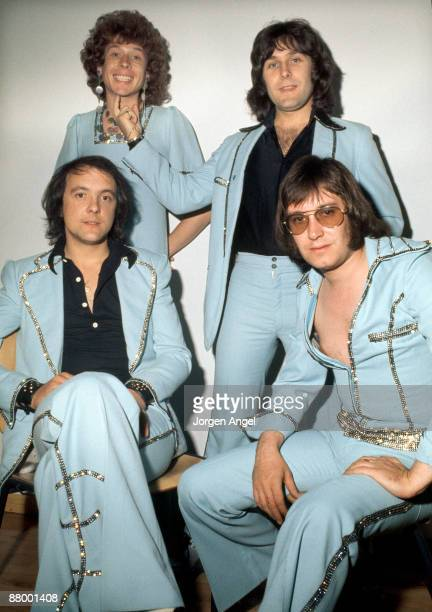 Mud backstage in Copenhagen Denmark in July 1974 LR Rob Davis Ray Stiles Front Dave Mount Les Gray